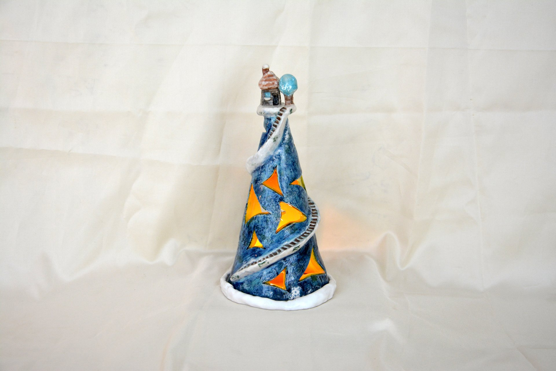Blue night light a Small house on the mountain - Ceramic new year's decor, height - 22 cm, diameter - 12 cm, photo 1 of 2.