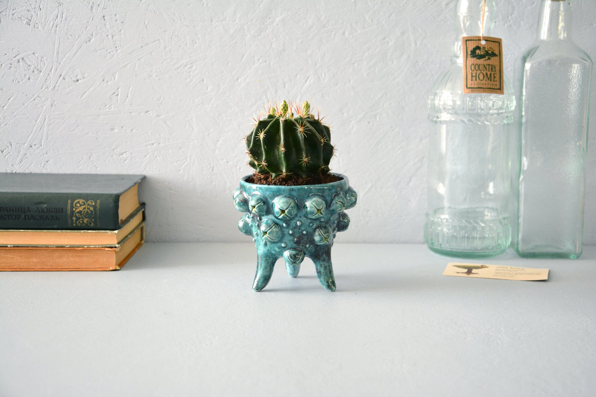 Ceramic cachepot for cactus on the legs Turquoise flicker, diameter - 10 cm, height - 9.5 cm, photo 1 of 4.