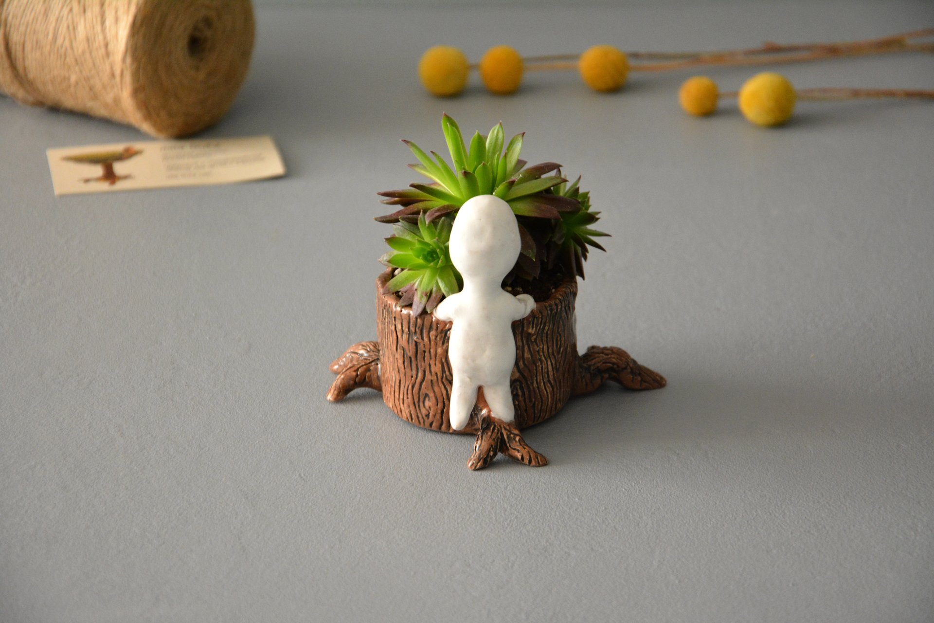 Kodama figurine tree spirit behind the stump, height - 9 cm, diameter of the stump - 6 cm, photo 4 of 8.