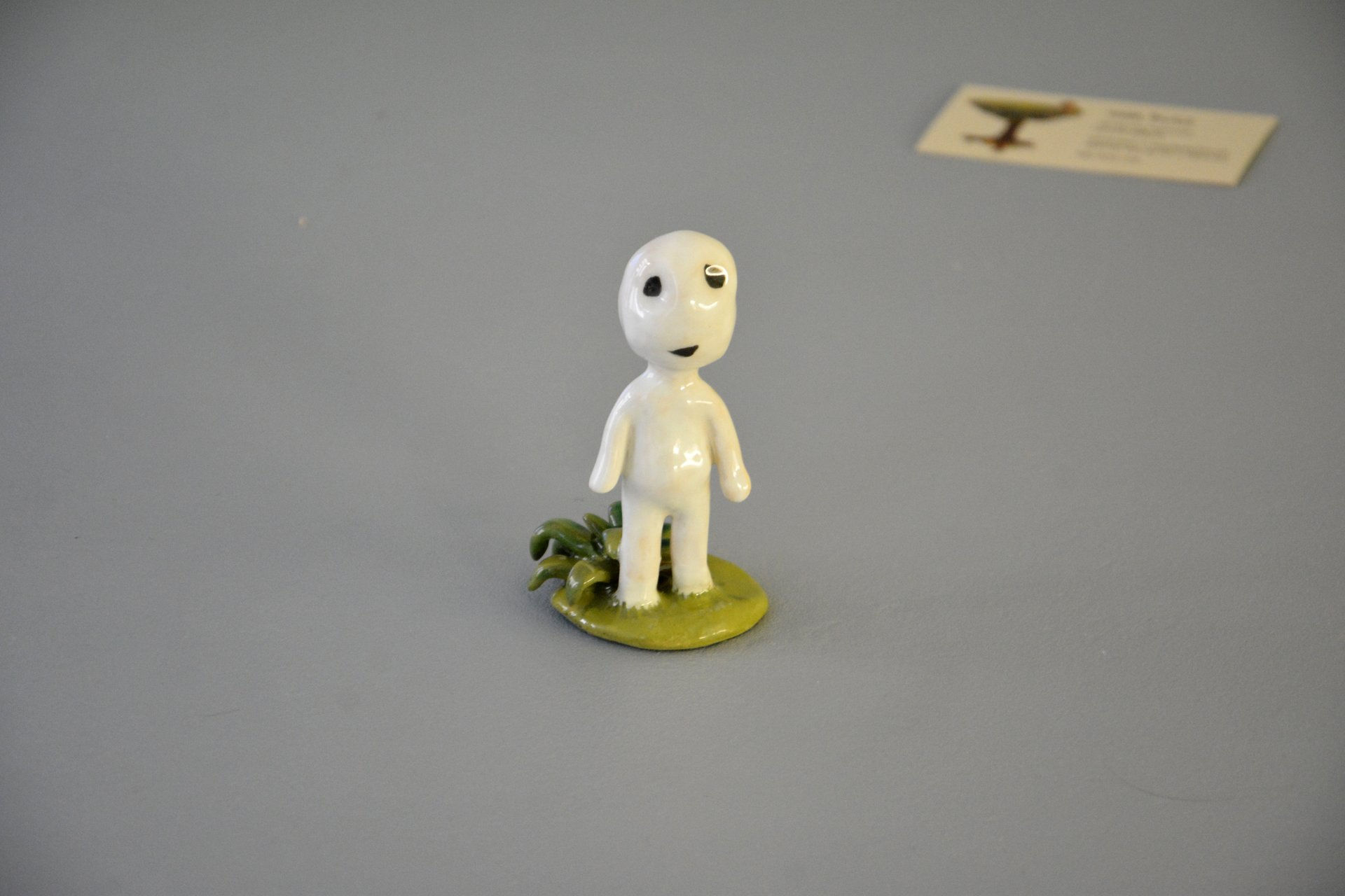 A figurine of a smiling Kodama tree spirit, height - 9.5 cm, photo 1 of 7.