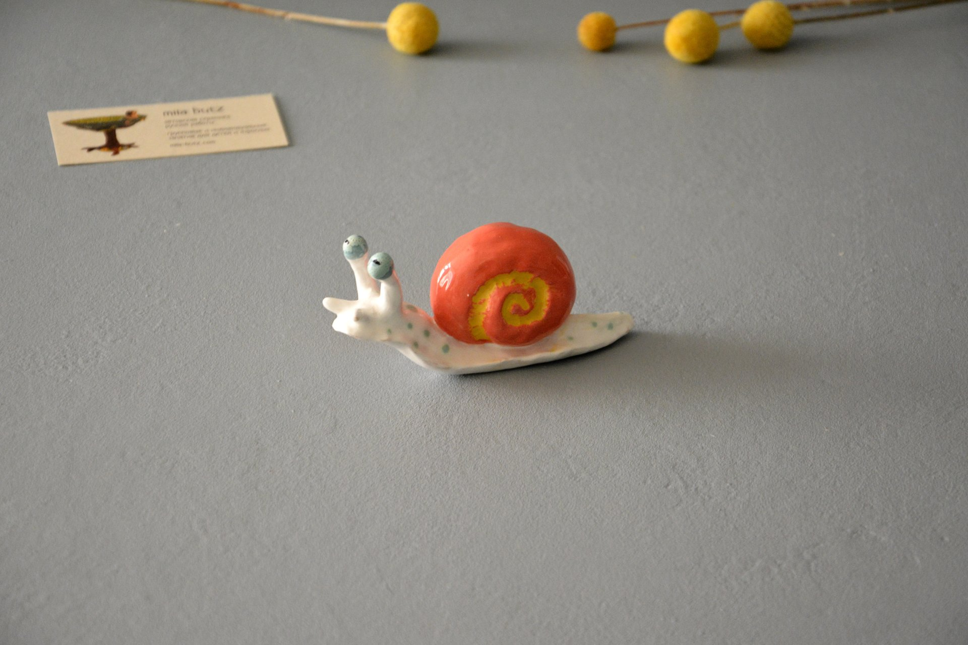 The figurine of a Cochlea is red-white, height - 4 cm, photo 4 of 6.